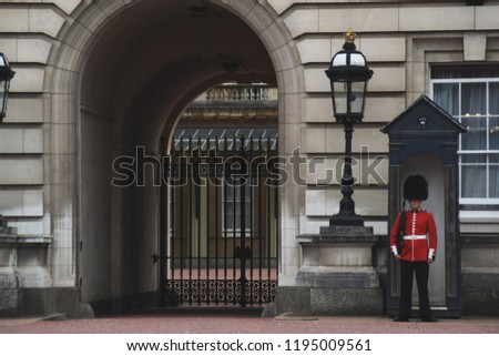Sentry of the Grenadier Guards posted outside Buckingham Palace - London, United Kingdom