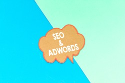 seo and adwords speech bubble isolated on pink and blue background