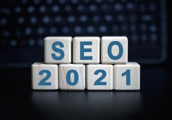 Seo 2021 concept - text in wooden cubes on a black keyboard