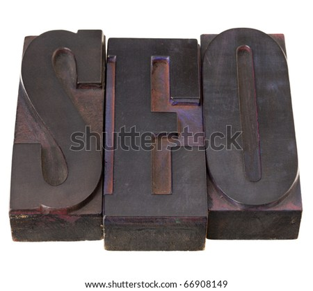 SEO (search engine optimization ) acronym - word in antique letterpress printing blocks, stained by color inks, isolated on white