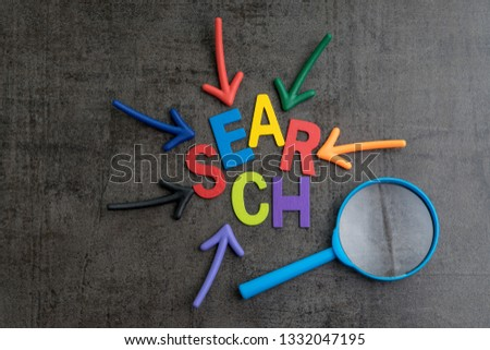 SEO, Search Engine Optimization ranking concept, arrows pointing to magnifying glass with the word Search at the center of cement wall chalkboard, the idea of promote traffic to website.