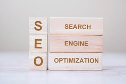 SEO (Search Engine Optimization) text wooden cube blocks on table background. Idea, Vision, Strategy, Analysis, Keyword and Content concept