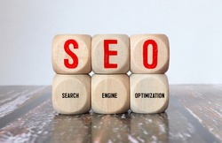 SEO Search Engine Optimization text wooden cube blocks on table background. Idea, Vision, Strategy, Analysis, Keyword and Content concept