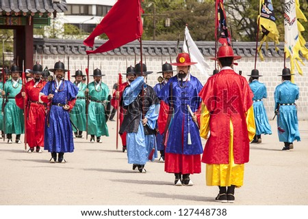 SEOUL, KOREA - APRIL 27: The ceremony to change the guards at the Gyeongbokgung Palace complex on April 27, 2012 in Seoul, Korea. The guards wear colorful uniforms in the pageant.
