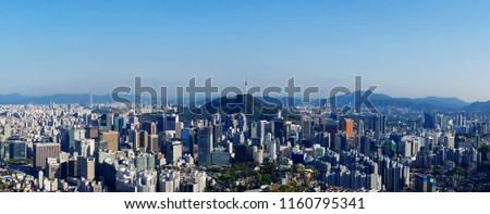Seoul skyline on a perfect day with a focus on Central Business District while parts of Gangnam Business District and Lotte Tower are visible in a distance.