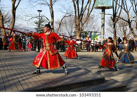 SEOUL, SOUTH KOREA - MARCH 22: Change of guards at the park in front of N Seoul Tower on March 22,2012 in Seoul, Korea.