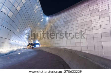 SEOUL, SOUTH KOREA - MARCH 29,2015: Dongdaemun Design Plaza at Night, New development in Seoul, designed by Zaha Hadid. Photo taken March 29, 2015 in Seoul, South Korea. #270633239