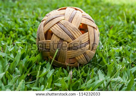 Sepak takraw ball on green grass