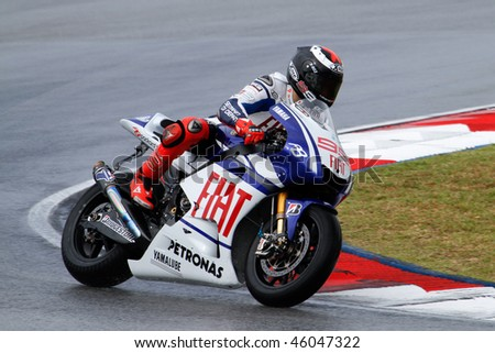 SEPANG - FEBRUARY 05: Jorge Lorenzo of the Fiat-Yamaha team practices in the pre-season testing in preparation for the MotoGP championship. February 05, 2010 in Sepang, Malaysia. - stock photo