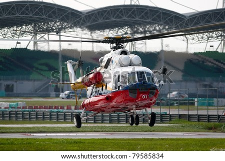 SEPANG - JUNE 17: A rescue helicopter from the Fire Department flies in on standby evacuation in the Sepang International Circuit during the GT Asia Series race on June 17, 2011 in Sepang, Malaysia.