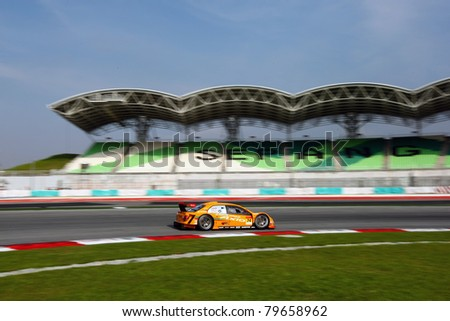 SEPANG - JUNE 19:apr team's Toyota Corolla Axio car drives by turn 1 at the Japan SUPER GT Round 3 race in Sepang International Circuit on June 19, 2011 in Sepang, Malaysia.