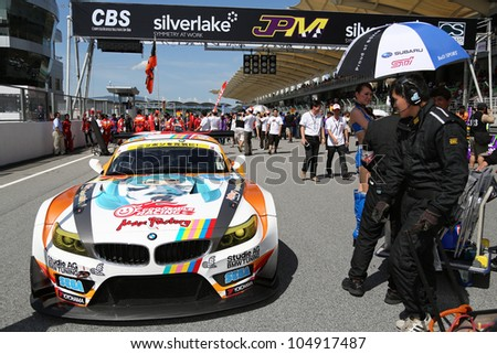 SEPANG - JUNE 10: The BMW Z4 GT3 car of GSR&Studie with TeamUKYO waits on the start grid on race day at the 2012 Autobacs SUPER GT Series Round 3 on June 10, 2012 at the Sepang Int. Circuit, Malaysia. - stock photo
