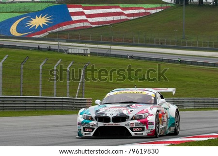 SEPANG - JUNE 19: The 'GSR&Studie with TeamUKYO' BMW car takes to the track of Sepang International Circuit during the Japan SUPER GT Round 3 race on June 19, 2011 in Sepang, Malaysia.