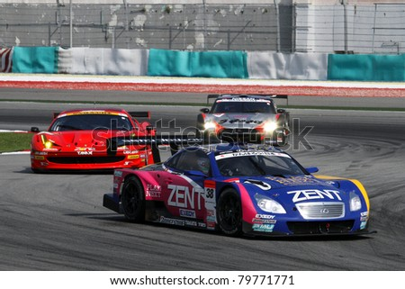 SEPANG - JUNE 19: The race car of Lexus Team Zent Cerumo moves into turn 2 closed followed by others during the Japan SUPER GT Round 3 race on June 19, 2011 in Sepang International Circuit, Malaysia.
