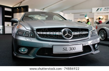 SEPANG, MALAYSIA - APRIL 8: A Mercedes SL300 car sits on display in the Mercedes Benz hall on the circuit ground at the Petronas Malaysian F1 Grand Prix on April 8, 2011 in Sepang, Malaysia.