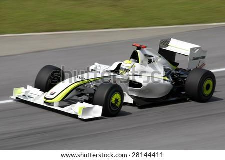 SEPANG, MALAYSIA - APRIL 3: BRAWN GP's Jenson Button practices at the 2009 F1 Petronas Malaysian Grand Prix April 3, 2009 in Sepang Malaysia. - stock photo