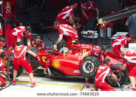 SEPANG, MALAYSIA - APRIL 8: Brazilian Felipe Massa of Scuderia Ferrari having a trial pitstop during Friday practice at Petronas Formula 1 Grand Prix on April 8, 2011 in Sepang, Malaysia