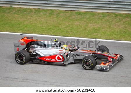 SEPANG, MALAYSIA - APRIL 4: British Lewis Hamilton of Team McLaren at top speed on the main straight at the Petronas Formula 1 Grand Prix April 4, 2010 in Sepang, Malaysia