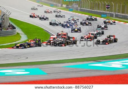 SEPANG, MALAYSIA - APRIL 10: Cars on track at race of Formula 1 GP, April 10 2011, Sepang, Malaysia. First lap.