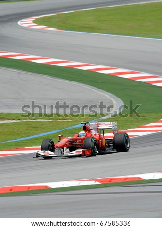 SEPANG, MALAYSIA - APRIL 2 : Ferrari Team Driver, Fernando Alonso action on track in Petronas Formula One 2010 at Sepang circuit. April 2, 2010 in Sepang, Malaysia - stock photo