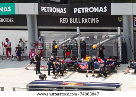 SEPANG, MALAYSIA - APRIL 8: German Sebastian Vettel of Red Bull Racing has a trial pitstop during Friday practice at Petronas Formula 1 Grand Prix on April 8, 2011 in Sepang, Malaysia
