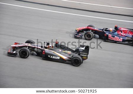 SEPANG, MALAYSIA - APRIL 4, 2010: Hispania Racing and Red Bull Racing battle for position in Formula 1 Petronas Malaysian Grand Prix on April 4, 2010 in Sepang, Malaysia