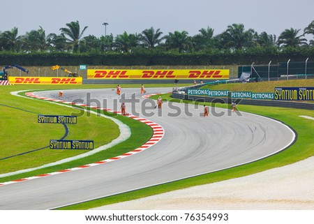 SEPANG, MALAYSIA - APRIL 9: Marshals clean track for qualification of Formula 1 GP, April 9 2011, Sepang, Malaysia