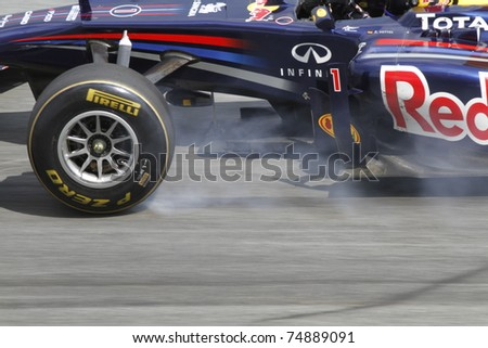 SEPANG, MALAYSIA - APRIL 8: Sebastian Vettel of Red Bull Racing brakes hard during PETRONAS Malaysian Grand Prix on April 8, 2011 in Sepang, Malaysia. The race will be held on Sunday April 10, 2011.