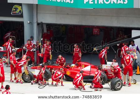 SEPANG, MALAYSIA - APRIL 8: Spanish Fernando Alonso of Scuderia Ferrari having a trial pitstop during Friday practice at Petronas Formula 1 Grand Prix on April 8, 2011 in Sepang, Malaysia