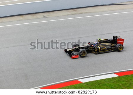 SEPANG, MALAYSIA - APRIL 8: Vitaly Petrov (team Lotus Renault) at first practice on Formula 1 GP, April 8 2011, Sepang, Malaysia