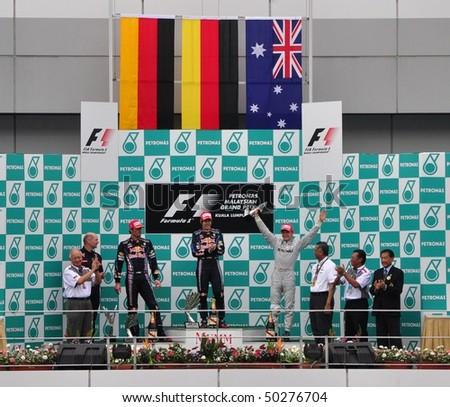 SEPANG, MALAYSIA - APRIL 4, 2010: Winners of Formula 1 Petronas Malaysian Grand Prix at the podium on April 4, 2010 in Sepang, Malaysia