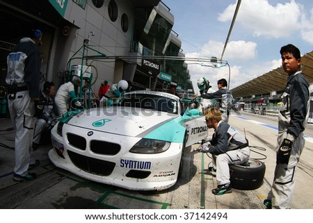 SEPANG, MALAYSIA - AUGUST 8: Petronas Team car refuels during pit stop at the 12 hour race of the 2009 Merdeka Millennium Endurance Race August 8, 2009 in Sepang, Malaysia.