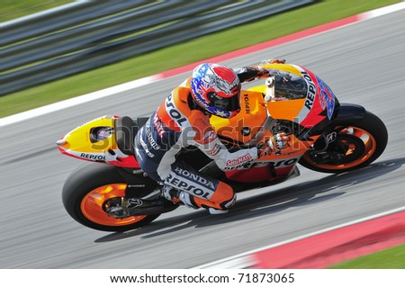SEPANG, MALAYSIA-FEB 24: Casey Stoner of Repsol Honda Team takes a corner at MotoGP Official Test Sepang 2 on Feb 24, 2011 in Sepang, Malaysia.