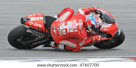 SEPANG, MALAYSIA - FEB. 25 : Ducati Marlboro Team rider Casey Stoner of Australia takes a corner during the 2010 pre-season test at Sepang circuit February 25, 2010 in Sepang, Malaysia.