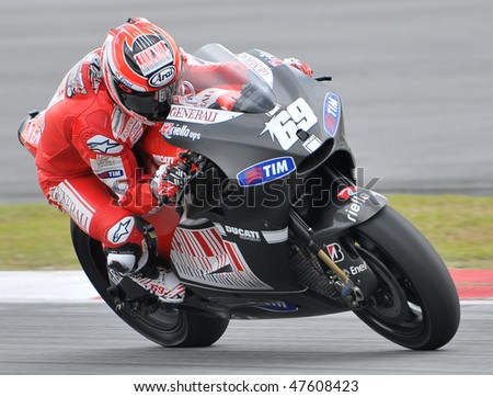 SEPANG, MALAYSIA - FEB. 25 : Ducati Marlboro Team rider Nicky Hayden of USA takes a corner during the 2010 pre-season test at Sepang circuit February 25, 2010 in Sepang, Malaysia.