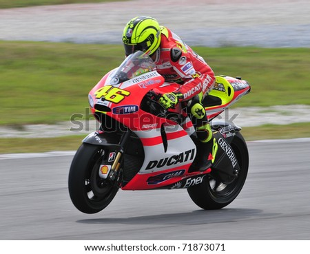 SEPANG, MALAYSIA-FEB 24: Valentino Rossi of Ducati Marlboro Team does a wheelie at MotoGP Official Test Sepang 2 on Feb 24, 2011 in Sepang, Malaysia.