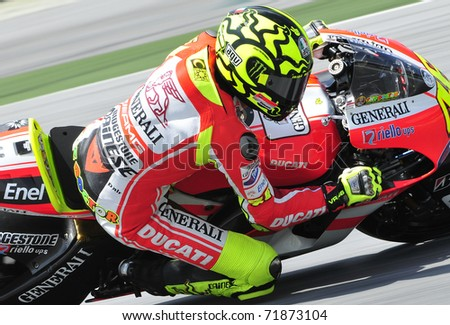 SEPANG, MALAYSIA-FEB 24: Valentino Rossi of Ducati Marlboro Team takes a corner at MotoGP Official Test Sepang 2 on Feb 24, 2011 in Sepang, Malaysia.