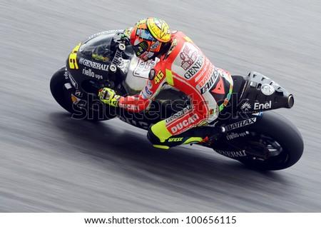 SEPANG, MALAYSIA-FEB 29: Valentino Rossi of Ducati takes a corner at MotoGP Official Test Sepang 2 on Feb 29, 2012 in Sepang, Malaysia.