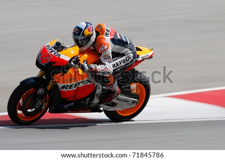 SEPANG, MALAYSIA - FEBRUARY 23: MotoGP rider Andrea Dovizioso of Repsol Honda Team practices at the 2011 MotoGP winter tests at the Sepang International Circuit. February 23, 2011 in Malaysia.