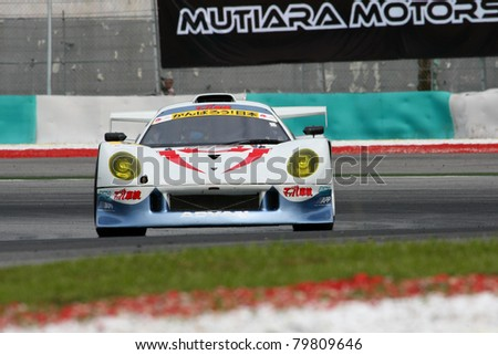 SEPANG, MALAYSIA - JUNE 18: GT 300 Team MACH's Syaken RD320R car puts in some practice laps in the Sepang International Circuit during the Japan SUPER GT Round 3 on June 18, 2011 in Sepang, Malaysia.