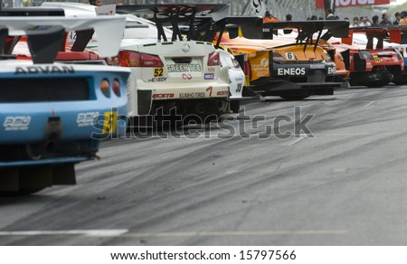 Sepang, Malaysia - June 22, 2008: Participating GT cars lining up after race at Super GT Malaysia Championship 2008.