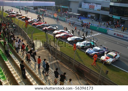 SEPANG, MALAYSIA-JUNE 20 : Race cars stop along the finishing line after the end of the Super GT car race on June 20, 2010 in Sepang Circuit, Malaysia.