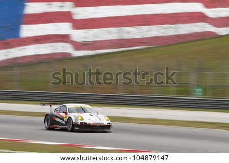 SEPANG, MALAYSIA - JUNE 10: Team Hankook in their Porsche 911 exits turn 2 at Super GT Race June 10, 2012 in Sepang, Malaysia. Team Hankook won the GT3 race - stock photo