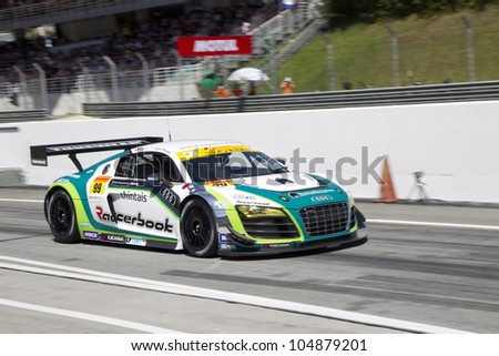 SEPANG, MALAYSIA - JUNE 10: Team Hitotsuyama in their Audi R8 exits the pitlane at Super GT Race June 10, 2012 in Sepang, Malaysia
