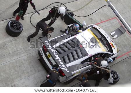 SEPANG, MALAYSIA - JUNE 10: Team JLOC in their Lamborghini Gellardo pits to change drivers at Super GT Race June 10, 2012 in Sepang, Malaysia