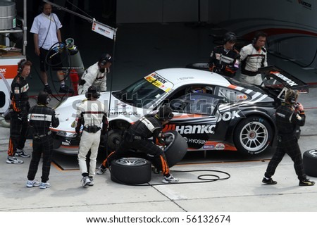 SEPANG, MALAYSIA - JUNE 21: The Hankook Porsche (33) in the pit lane for tire change at the Super GT International Series Round 4 race. June 21, 2010 in Sepang Malaysia.
