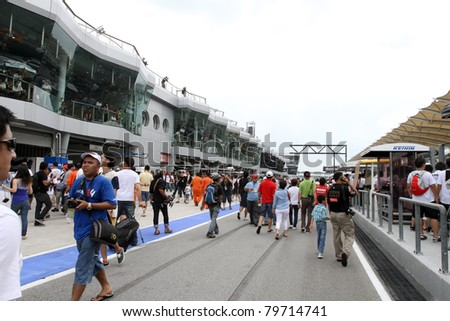 SEPANG, MALAYSIA - JUNE 19: The Sepang International Circuit opens the pit-lanes to fans to take a closer look at the cars before the Japan SUPER GT Round 3 race on June 19, 2011 in Sepang, Malaysia.