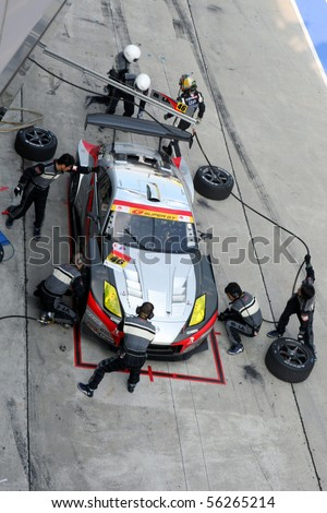 SEPANG, MALAYSIA - JUNE 21: The Up Start Mola Z car (46) stopping for tite change during the Super GT International Series Round 4 race. June 21, 2010 in Sepang Malaysia. - stock photo