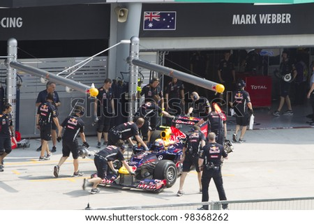 SEPANG, MALAYSIA - MARCH 23: Australian Mark Webber of Team Red Bull pushed back to his pit garage during Friday practice at Petronas Formula 1 Grand Prix March 23, 2012 in Sepang, Malaysia