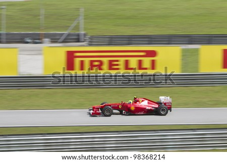 SEPANG, MALAYSIA - MARCH 23: Brazilian Felipe Massa of Team Scuderia Ferrari enters the pitlane road during Friday practice at Petronas Formula 1 Grand Prix March 23, 2012 in Sepang, Malaysia